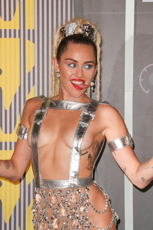 08/30/2015 - Miley Cyrus - 2015 MTV Video Music Awards - Arrivals - Microsoft Theater - Los Angeles, CA, USA - Keywords: Vertical, California, MTV VMA's, Music, Award Show, Portrait, Photography, Arts Culture and Entertainment, Attending, Celebrities, Celebrity, Musician, Arrival Orientation: Portrait Face Count: 1 - False - Photo Credit: PRPhotos.com - Contact (1-866-551-7827) - Portrait Face Count: 1